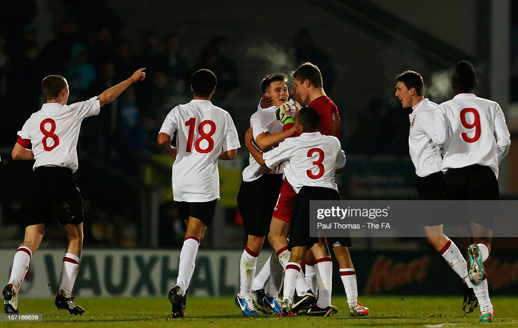 Giorgio Rasulo (C) of England U16 celebrates with team mates after scoring the opening goal during the Sky Sports Victory Shield match between England U16 and Scotland U16 at Pirelli Stadium on November 29, 2012 in Burton-upon-Trent, England.