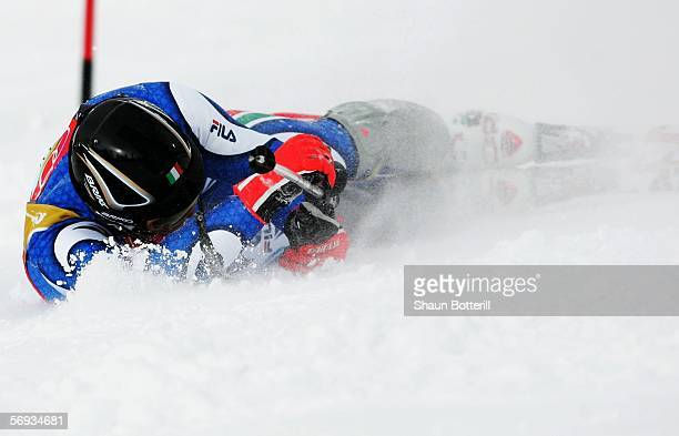 Giorgio Rocca of Italy lies on the snow after failing to finish in the Final of the Mens Alpine Skiing Slalom on Day 15 of the 2006 Turin Winter...