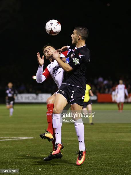 Giorgio Speranza of Blacktown City is challenged by Josh Risdon of the Wanderers during the FFA Cup Quarterfinal match between Blacktown City and the...