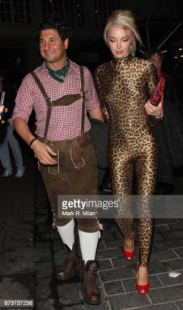 Giorgio Veroni and Tamara Beckwith depart Caprice Bourret's 40th birthday and Halloween party at the Cuckoo Club on October 27 2011 in London England