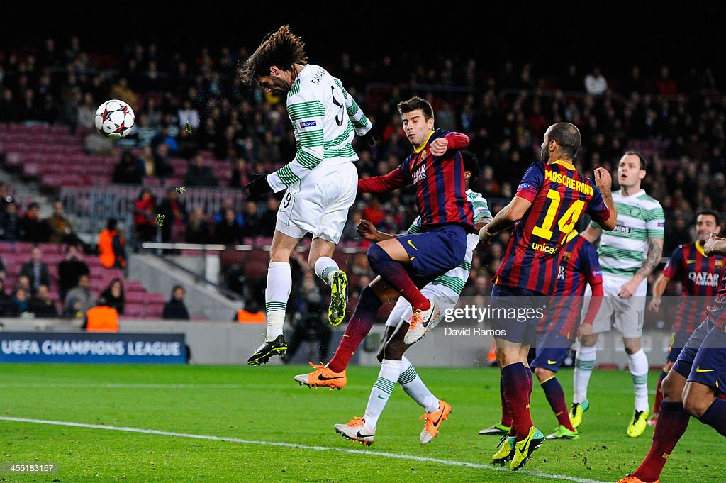 Giorgios Samaras of Celtic FC scores his team's first goal during the Champions League Group H match between FC Barcelona and Celtic FC at Camp Nou on December 11, 2013 in Barcelona, Spain.