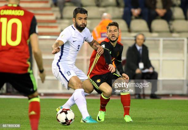 Giorgios Tzavellas of Greece and Dries Mertens of Belgium in action during the FIFA 2018 World Cup Qualifier between Belgium and Greece at Stade Roi...