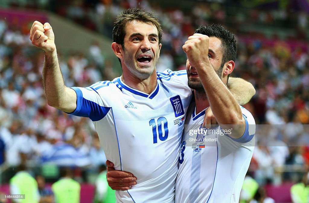 <a gi-track='captionPersonalityLinkClicked' href=/galleries/search?phrase=Giorgos+Karagounis&family=editorial&specificpeople=240229 ng-click='$event.stopPropagation()'>Giorgos Karagounis</a> and Giorgos Tzavelas of Greece celebrate victory and progress to the quarter finals during the UEFA EURO 2012 group A match between Greece and Russia at The National Stadium on June 16, 2012 in Warsaw, Poland.