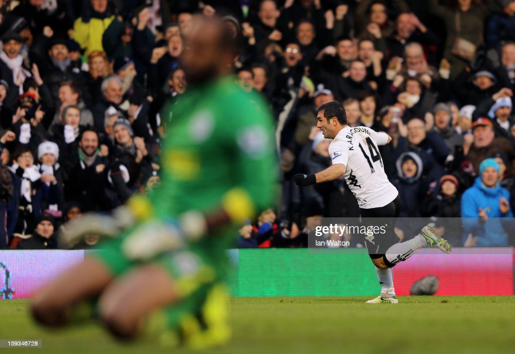 Giorgos Karagounis of Fulham celebrates after scoring the opening goal whilst a dejected <a gi-track='captionPersonalityLinkClicked' href=/galleries/search?phrase=Ali+Al+Habsi&family=editorial&specificpeople=1029315 ng-click='$event.stopPropagation()'>Ali Al Habsi</a> of Wigan looks on during the Barclays Premier League match between Fulham and Wigan Athletic at Craven Cottage on January 12, 2013 in London, England.