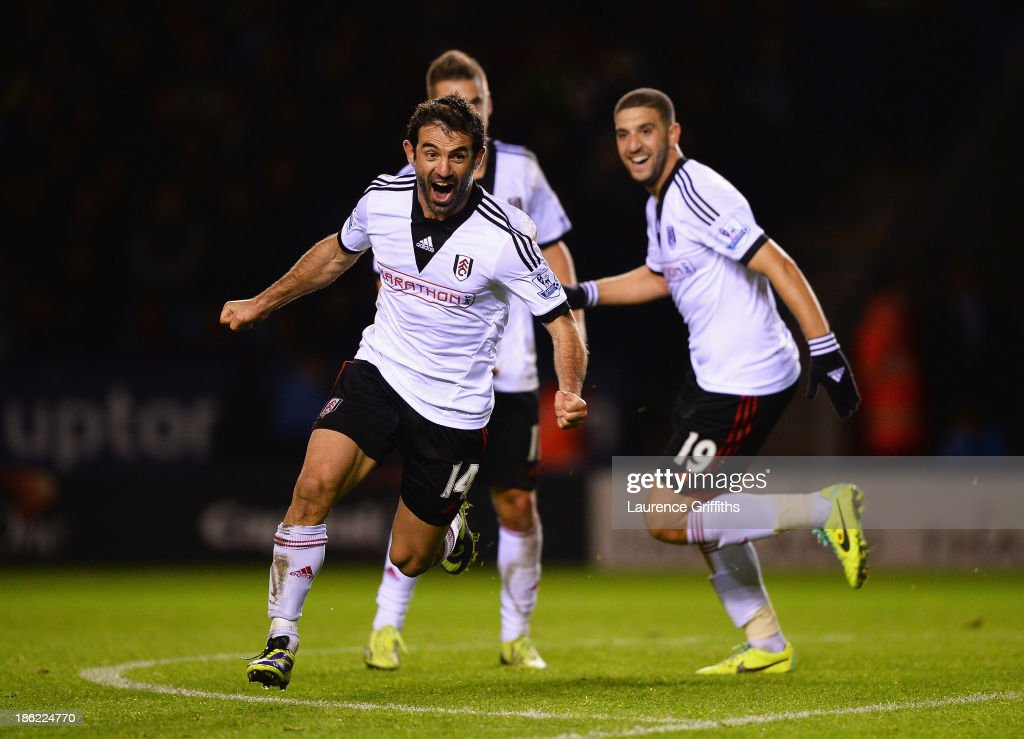 Giorgos Karagounis of Fulham celebrates scoring his team's third goal during the Capital One Cup fourth round match between Leicester City and Fulham at the King Power Stadium on October 29, 2013 in Leicester, England.