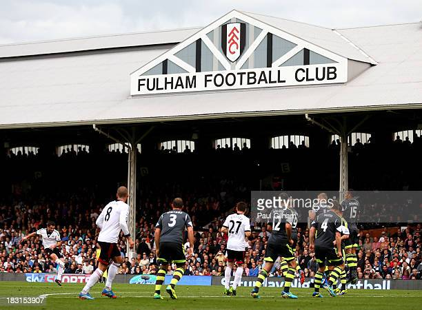 Giorgos Karagounis of Fulham takes a free kick during the Barclays Premier League match between Fulham and Stoke City at Craven Cottage on October 5...
