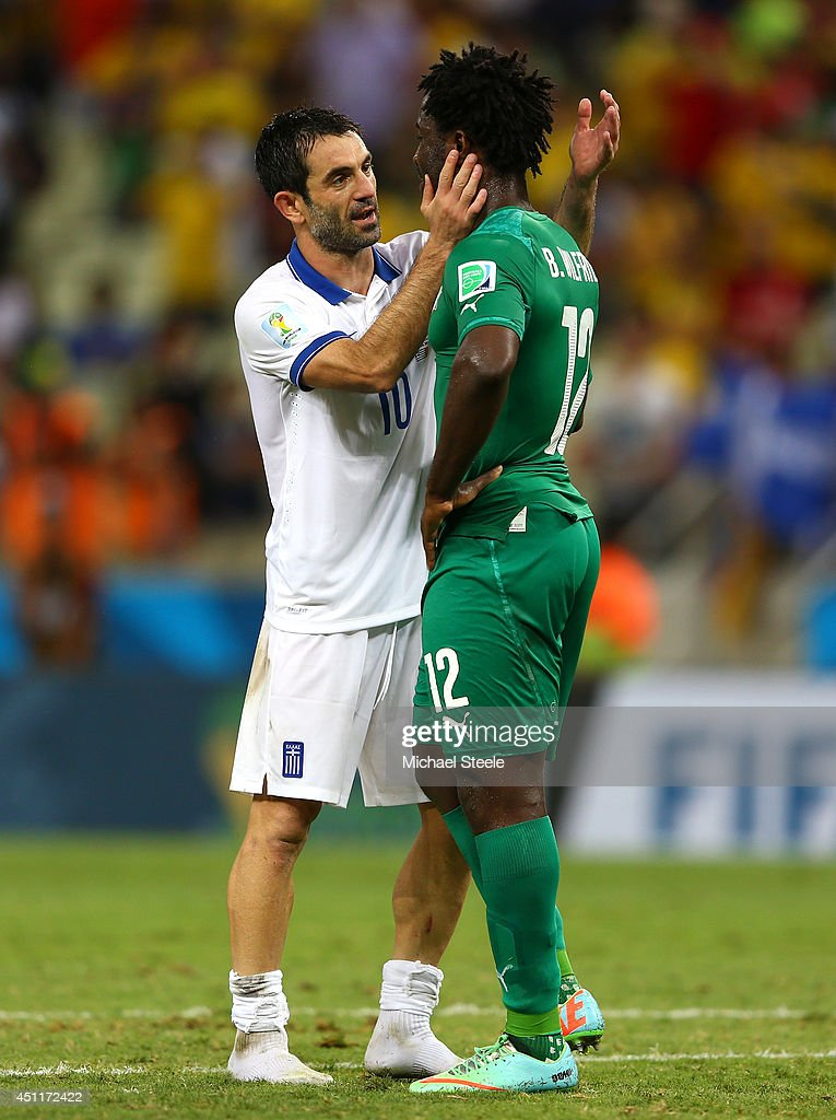 <a gi-track='captionPersonalityLinkClicked' href=/galleries/search?phrase=Giorgos+Karagounis&family=editorial&specificpeople=240229 ng-click='$event.stopPropagation()'>Giorgos Karagounis</a> of Greece and <a gi-track='captionPersonalityLinkClicked' href=/galleries/search?phrase=Wilfried+Bony&family=editorial&specificpeople=4231248 ng-click='$event.stopPropagation()'>Wilfried Bony</a> of the Ivory Coast interact after Greece's 2-1 win during the 2014 FIFA World Cup Brazil Group C match between Greece and the Ivory Coast at Castelao on June 24, 2014 in Fortaleza, Brazil.