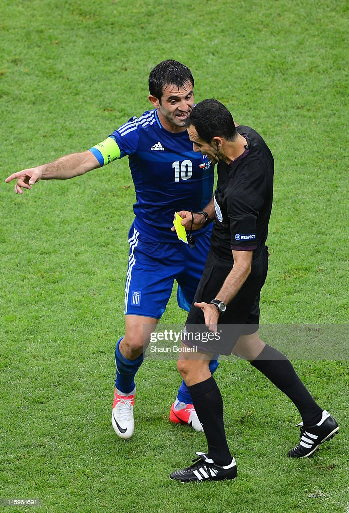 Giorgos Karagounis of Greece appeal to Referee Carlos Velasco Carballo for handball during the UEFA EURO 2012 group A match between Poland and Greece at The National Stadium on June 8, 2012 in Warsaw, Poland.