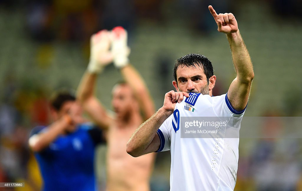 Giorgos Karagounis of Greece celebrates after defeating the Ivory Coast 2-1 during the 2014 FIFA World Cup Brazil Group C match between Greece and the Ivory Coast at Castelao on June 24, 2014 in Fortaleza, Brazil.