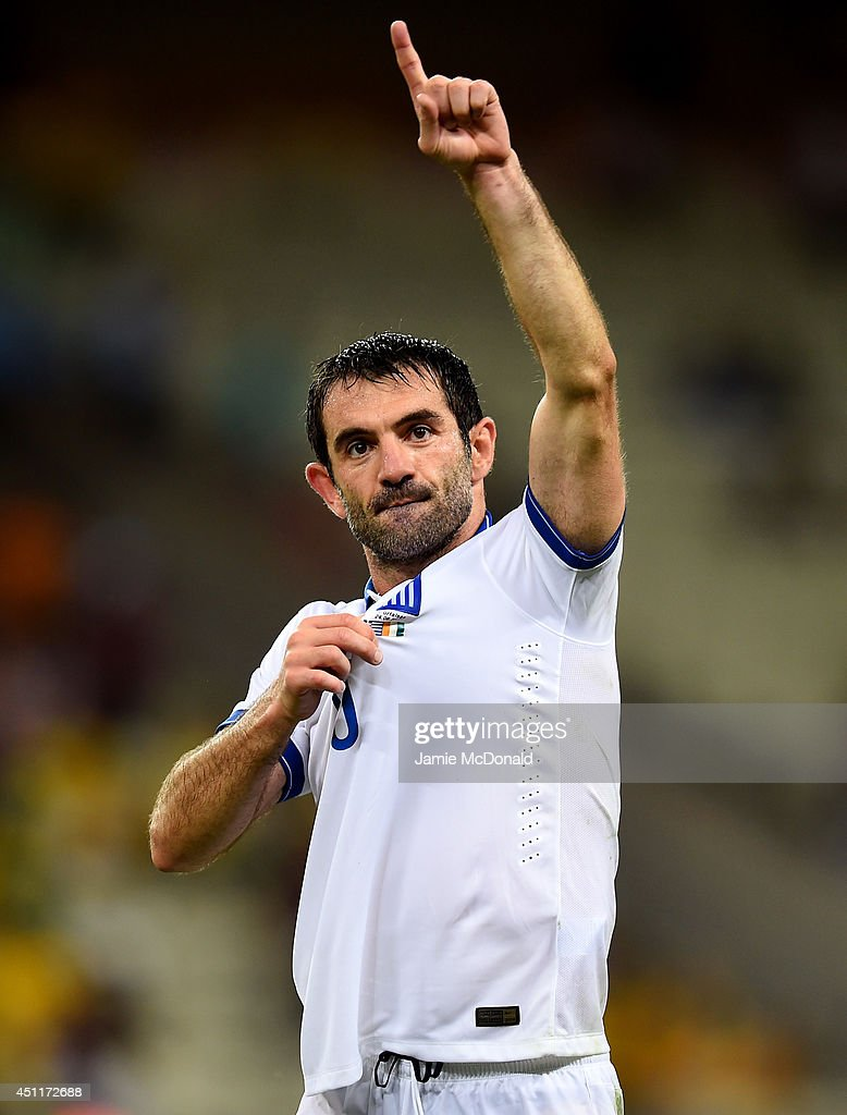 <a gi-track='captionPersonalityLinkClicked' href=/galleries/search?phrase=Giorgos+Karagounis&family=editorial&specificpeople=240229 ng-click='$event.stopPropagation()'>Giorgos Karagounis</a> of Greece celebrates after defeating the Ivory Coast 2-1 during the 2014 FIFA World Cup Brazil Group C match between Greece and the Ivory Coast at Castelao on June 24, 2014 in Fortaleza, Brazil.
