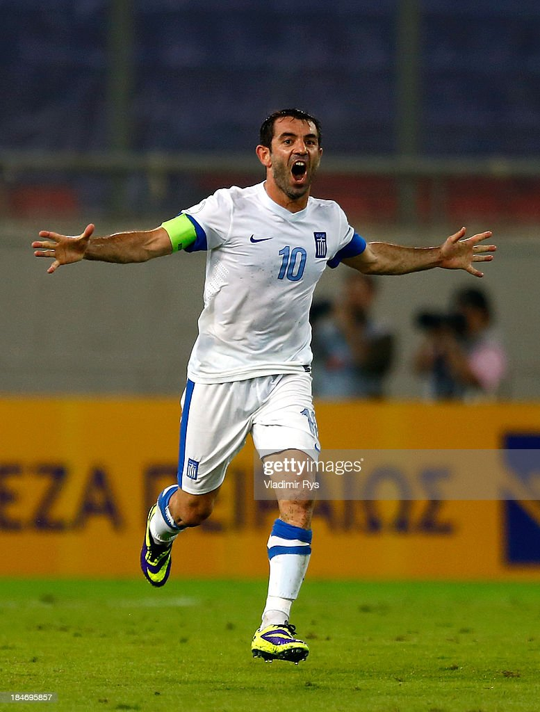 <a gi-track='captionPersonalityLinkClicked' href=/galleries/search?phrase=Giorgos+Karagounis&family=editorial&specificpeople=240229 ng-click='$event.stopPropagation()'>Giorgos Karagounis</a> of Greece celebrates after scoring his team's second goal during the group G FIFA 2014 World Cup Qualifier match between Greece and Liechtenstein at Karaiskakis Stadium on October 15, 2013 in Athens, Greece.