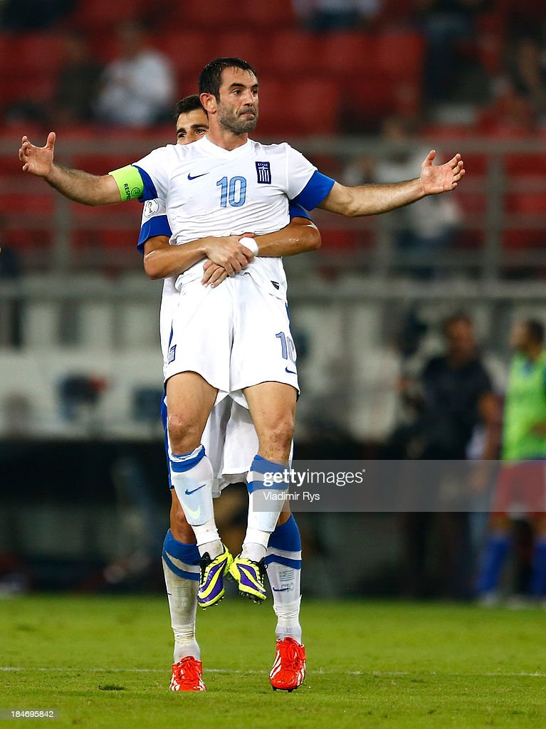 Giorgos Karagounis of Greece celebrates scoring with team mate Dimitris Siovas after scoring his team's second goal during the group G FIFA 2014 World Cup Qualifier match between Greece and Liechtenstein at Karaiskakis Stadium on October 15, 2013 in Athens, Greece.