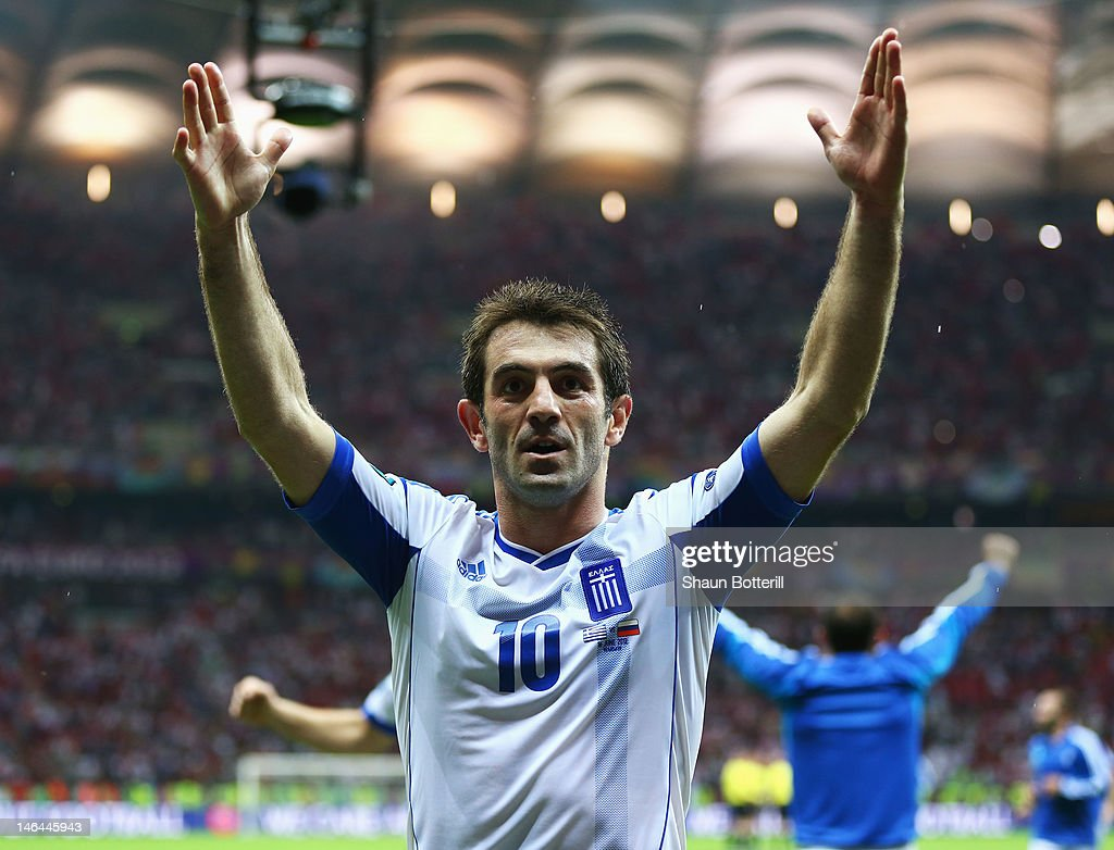 <a gi-track='captionPersonalityLinkClicked' href=/galleries/search?phrase=Giorgos+Karagounis&family=editorial&specificpeople=240229 ng-click='$event.stopPropagation()'>Giorgos Karagounis</a> of Greece celebrates victory and progress to the quarter finals during the UEFA EURO 2012 group A match between Greece and Russia at The National Stadium on June 16, 2012 in Warsaw, Poland.