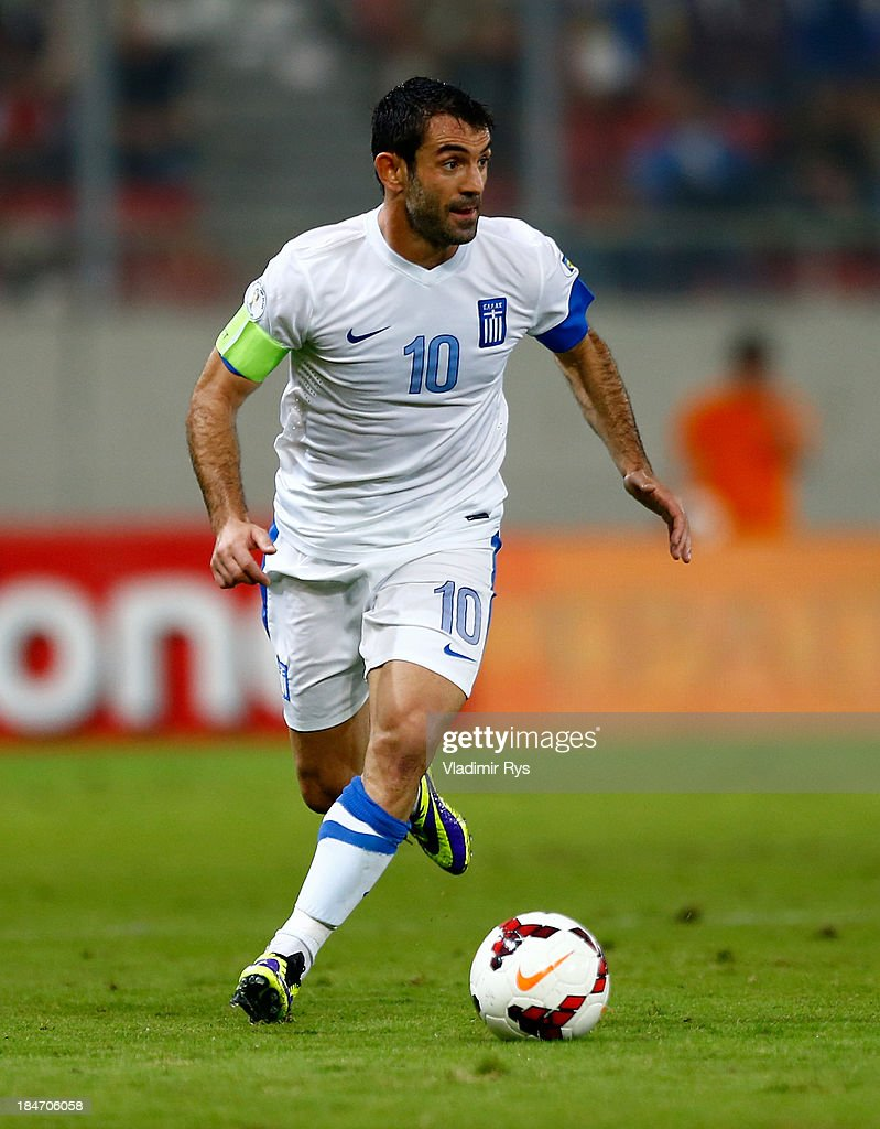 <a gi-track='captionPersonalityLinkClicked' href=/galleries/search?phrase=Giorgos+Karagounis&family=editorial&specificpeople=240229 ng-click='$event.stopPropagation()'>Giorgos Karagounis</a> of Greece in action during the group G FIFA 2014 World Cup Qualifier match between Greece and Liechtenstein at Karaiskakis Stadium on October 15, 2013 in Athens, Greece.