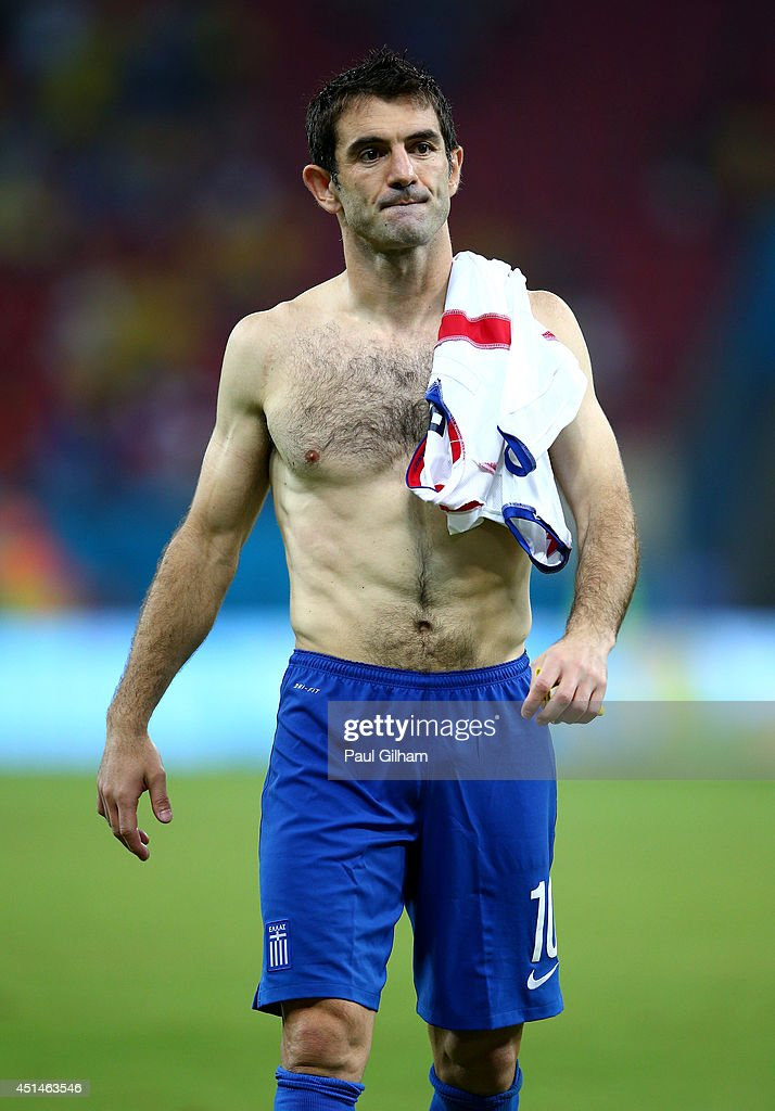 <a gi-track='captionPersonalityLinkClicked' href=/galleries/search?phrase=Giorgos+Karagounis&family=editorial&specificpeople=240229 ng-click='$event.stopPropagation()'>Giorgos Karagounis</a> of Greece looks dejected after being defeated by Costa Rica in a penalty shootout during the 2014 FIFA World Cup Brazil Round of 16 match between Costa Rica and Greece at Arena Pernambuco on June 29, 2014 in Recife, Brazil.
