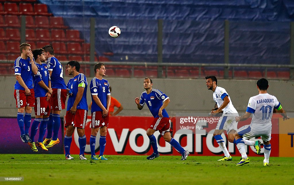Giorgos Karagounis of Greece scores his team's second goal from a free kick during the group G FIFA 2014 World Cup Qualifier match between Greece and Liechtenstein at Karaiskakis Stadium on October 15, 2013 in Athens, Greece.