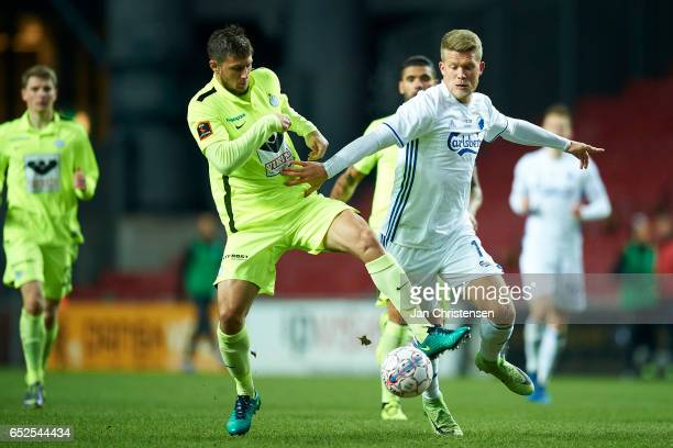 Giorgos Katsikas of Esbjerg fB and Andreas Cornelius of FC Copenhagen compete for the ball during the Danish Alka Superliga match between FC...