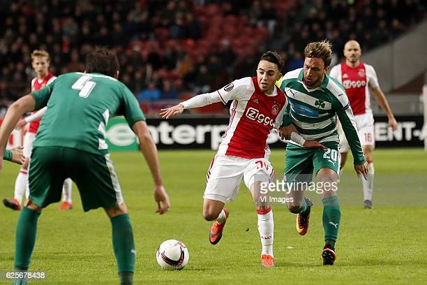 Giorgos Koutroumpis of Panathinaikos FC Abdelhak Nouri of Ajax Lautaro Rinaldi of Panathinaikos FCduring the UEFA Europa League group G match between...