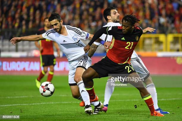 Giorgos Merkis defender of Cyprus Kostas Laifis defender of Cyprus Michy Batshuayi forward of Belgium during the World Cup Qualifier Group H match...