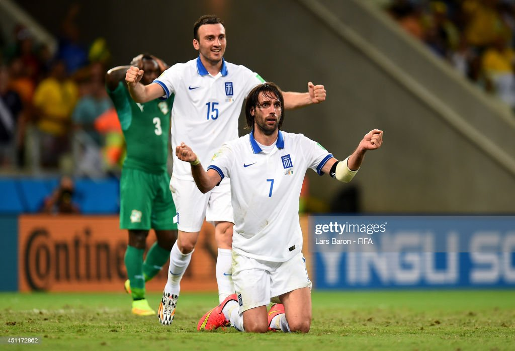 Giorgos Samaras and <a gi-track='captionPersonalityLinkClicked' href=/galleries/search?phrase=Vasilis+Torosidis&family=editorial&specificpeople=4542702 ng-click='$event.stopPropagation()'>Vasilis Torosidis</a> of Greece celebrate as they are awarded a penalty during the 2014 FIFA World Cup Brazil Group C match between Greece and Cote D'Ivoire at Estadio Castelao on June 24, 2014 in Fortaleza, Brazil.