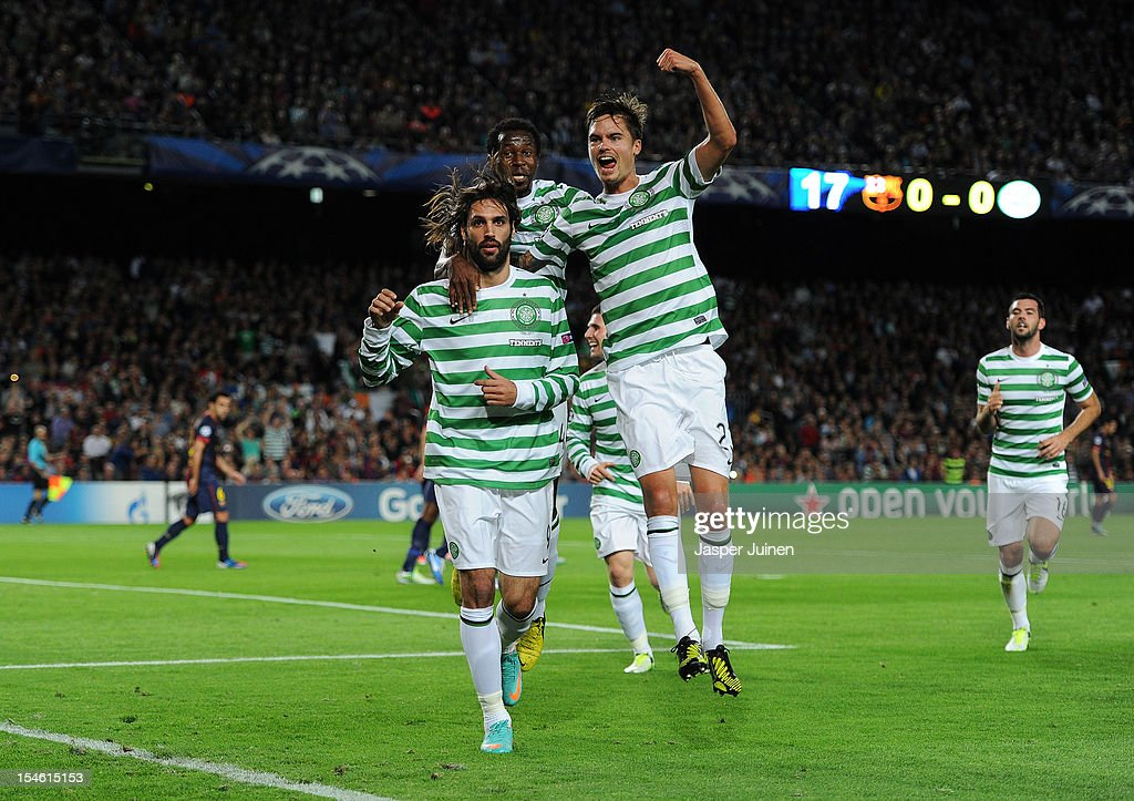 Giorgos Samaras (L) of Celtic FC celebrates scoring with his teammates Mikael Lustig (R) and <a gi-track='captionPersonalityLinkClicked' href=/galleries/search?phrase=Efe+Ambrose&family=editorial&specificpeople=4406353 ng-click='$event.stopPropagation()'>Efe Ambrose</a> during the UEFA Champions League group G match between FC Barcelona and Celtic FC at the Camp Nou stadium on October 23, 2012 in Barcelona, Spain.