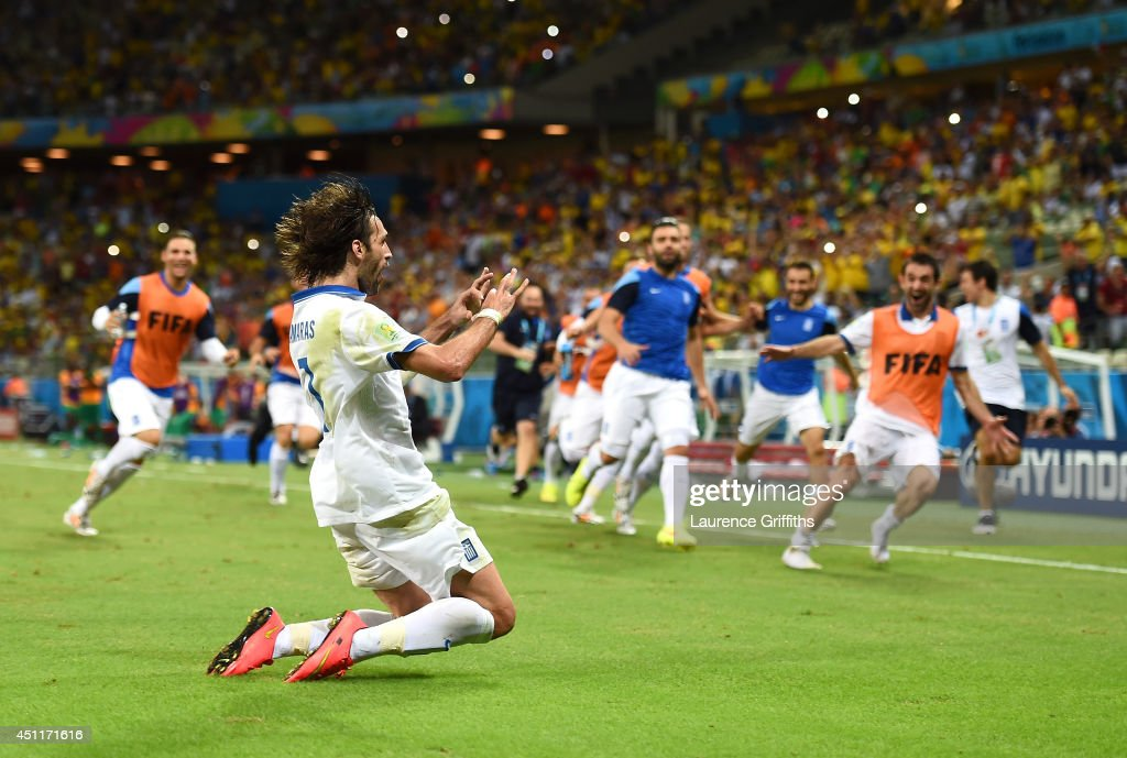 Giorgos Samaras of Greece celebrates scoring his team's second goal on a penalty kick during the 2014 FIFA World Cup Brazil Group C match between Greece and the Ivory Coast at Castelao on June 24, 2014 in Fortaleza, Brazil.