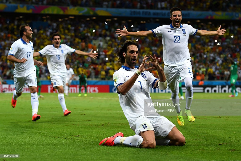 Giorgos Samaras (2nd R) of Greece celebrates scoring his team's second goal from the penalty spot with his teammates during the 2014 FIFA World Cup Brazil Group C match between Greece and Cote D'Ivoire at Estadio Castelao on June 24, 2014 in Fortaleza, Brazil.