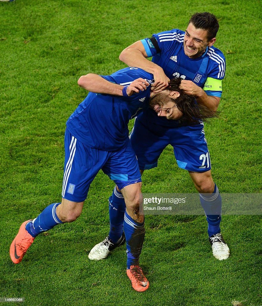 Giorgos Samaras of Greece celebrates scoring their first goal with Kostas Katsouranis during the UEFA EURO 2012 quarter final match between Germany and Greece at The Municipal Stadium on June 22, 2012 in Gdansk, Poland.