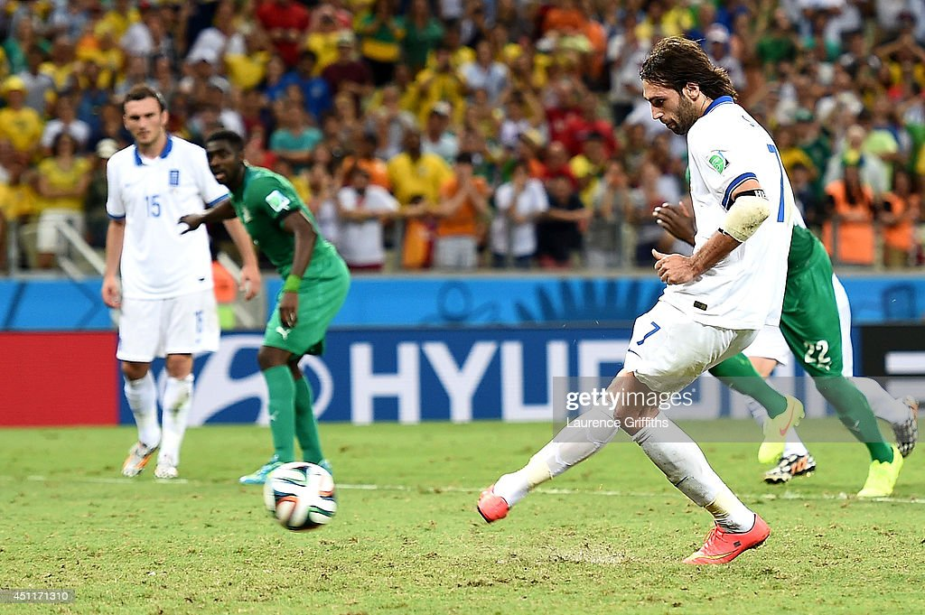 Giorgos Samaras of Greece scores his team's second goal on a penalty kick during the 2014 FIFA World Cup Brazil Group C match between Greece and the Ivory Coast at Castelao on June 24, 2014 in Fortaleza, Brazil.