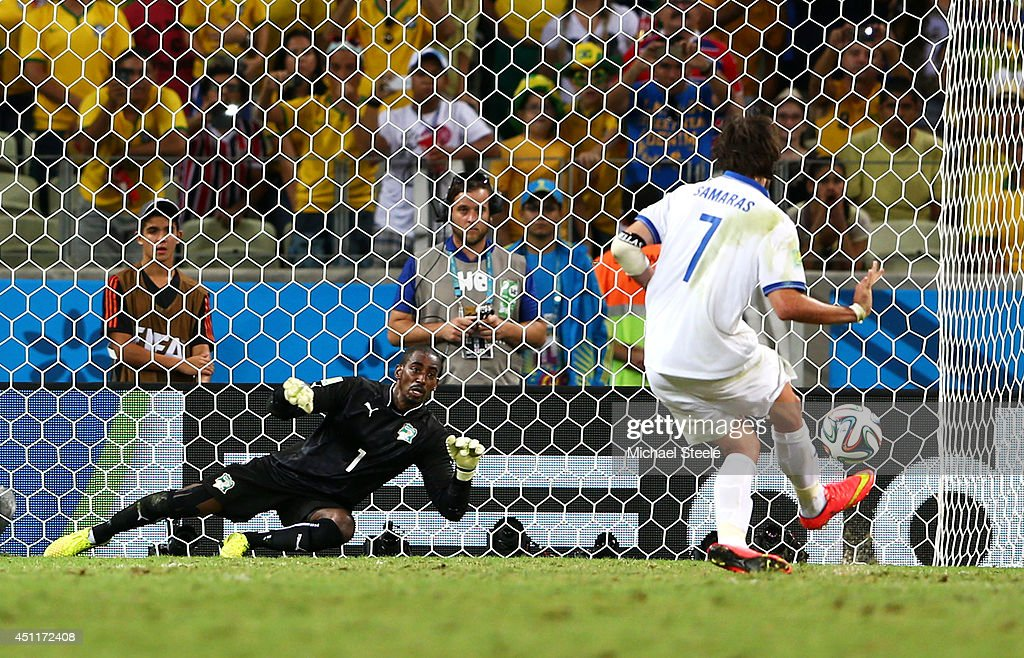 Giorgos Samaras of Greece scores his team's second goal on a penalty kick past <a gi-track='captionPersonalityLinkClicked' href=/galleries/search?phrase=Boubacar+Barry&family=editorial&specificpeople=550738 ng-click='$event.stopPropagation()'>Boubacar Barry</a> of the Ivory Coast during the 2014 FIFA World Cup Brazil Group C match between Greece and the Ivory Coast at Castelao on June 24, 2014 in Fortaleza, Brazil.