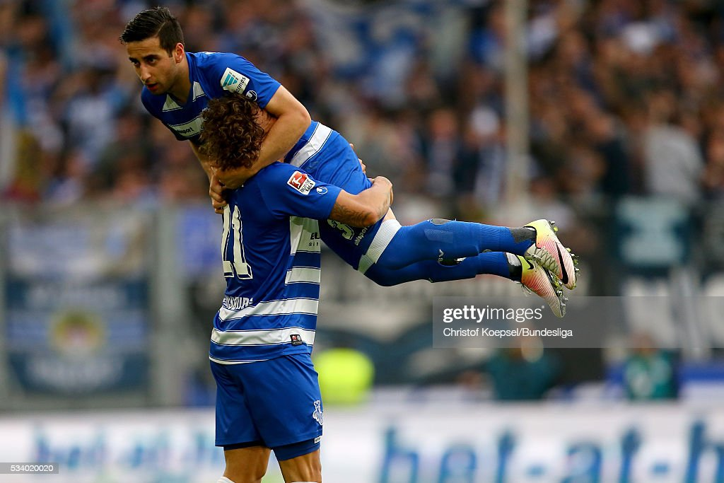 Giorigi Chanturia of Duisburg (up) celebrates the first goal with Rolf Feltscher of Duisburg (L) during the Second Bundesliga play-off second leg match between MSV Duisburg and Wuerzburger Kickers at Schauinsland-Reisen-Arena on May 24, 2016 in Duisburg, Germany.