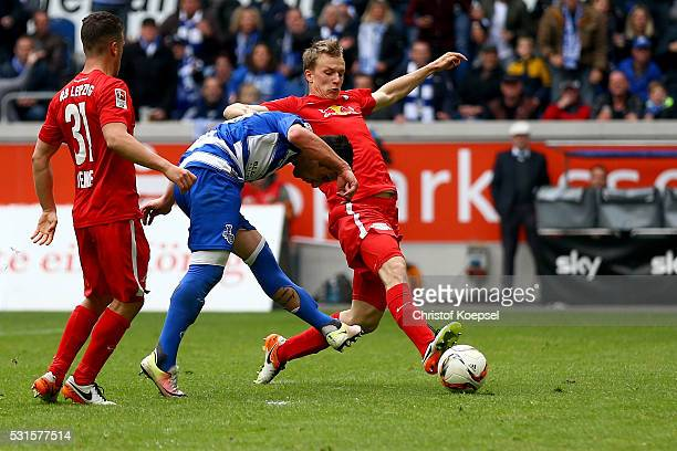 Giorigi Chanturia of Duisburg scores the first goal against Diego Demme of Leipzig and Georg Teigl of Leipzig during the Second Bundesliga match...