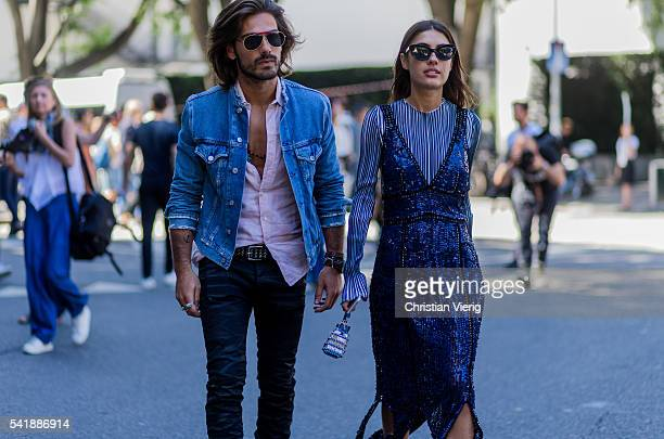 Giotto Calendoli and Patricia Manfield outside Armani during the Milan Men's Fashion Week Spring/Summer 2017 on June 20 2016 in Milan Italy