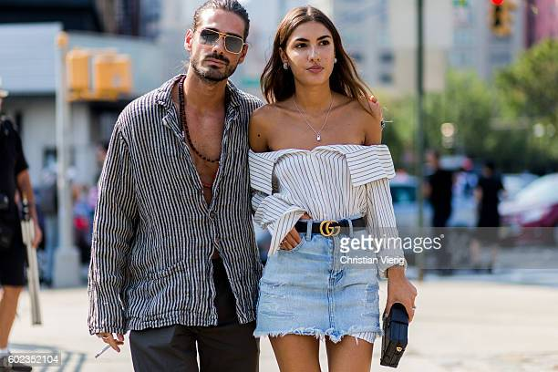 Giotto Calendoli and Patricia Manfield wearing an off shoulder button shirt Gucci belt and denim mini skirt outside Lacoste on September 10 2016 in...