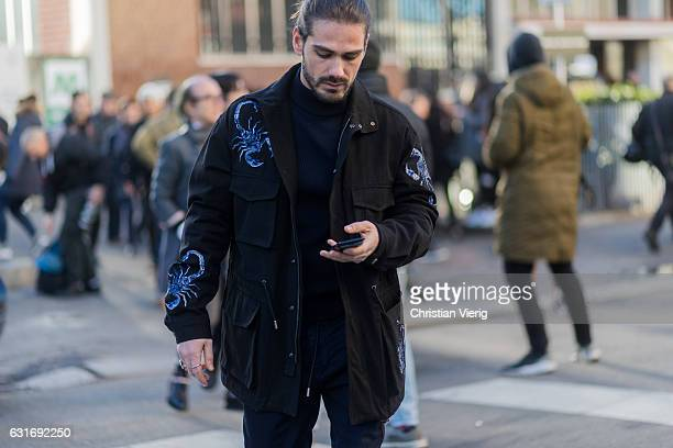 Giotto Calendoli is wearing a black jacket with print seen at Diesel during Milan Men's Fashion Week Fall/Winter 2017/18 on January 14 2017 in Milan...