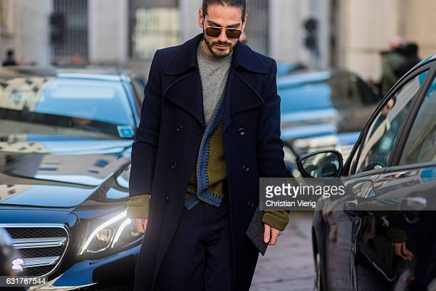 Giotto Calendoli is wearing a doublebreasted coat during Milan Men's Fashion Week Fall/Winter 2017/18 at Salvatore Ferragamo on January 15 2017 in...