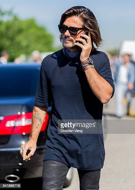 Giotto Calendoli wearing a black tshirt and bandana outside Diesel during the Milan Men's Fashion Week Spring/Summer 2017 on June 20 2016 in Milan...