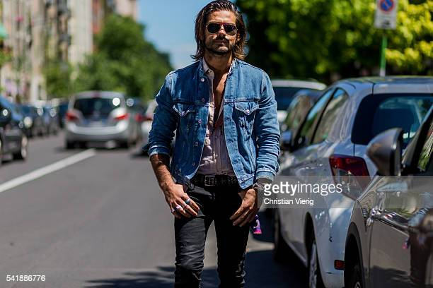 Giotto Calendoli wearing a blue denim jacket and black jeans outside Etro during the Milan Men's Fashion Week Spring/Summer 2017 on June 20 2016 in...
