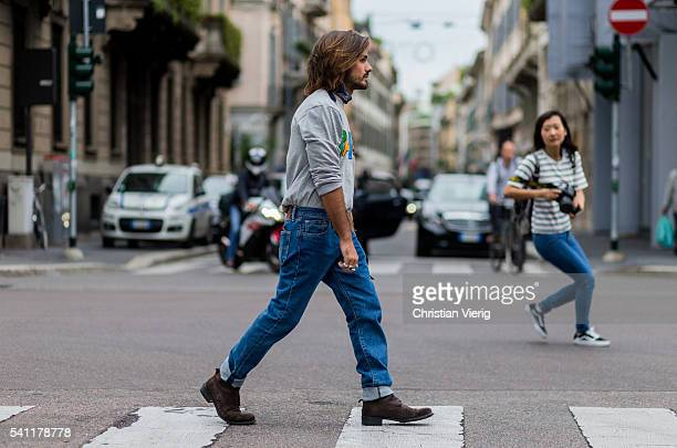 Giotto Calendoli wearing a grey Palace sweater and denim jeans and bandana outside Neil Barrett during the Milan Men's Fashion Week Spring/Summer...