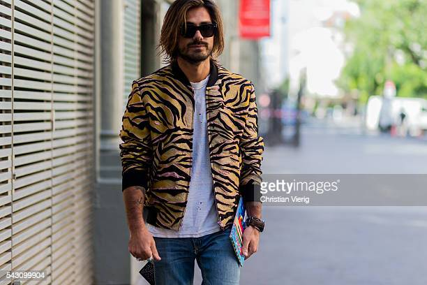 Giotto Calendoli wearing a yellow black Kenzo jacket and white tshirt outside during the Paris Fashion Week Menswear Spring/Summer 2017 on June 25...