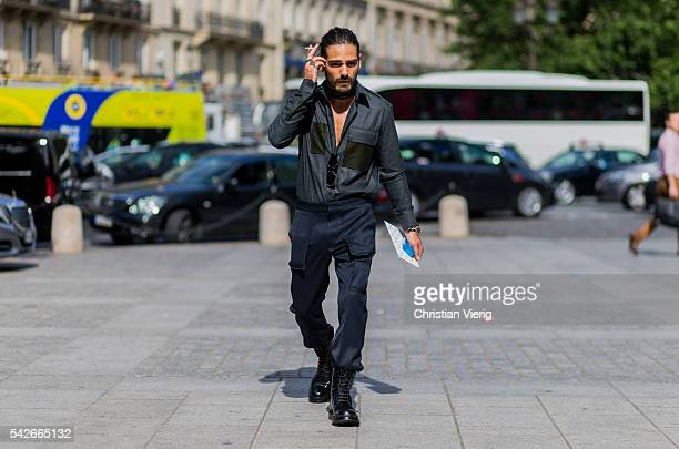 Giotto Calendoli wearing military pants and black boots outside Louis Vuitton during the Paris Fashion Week Menswear Spring/Summer 2017 on June 23...