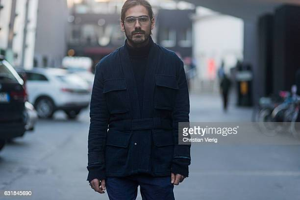 Giotto Calendoli wearing wearing a navy jacket navy pants glasses at Etro during Milan Men's Fashion Week Fall/Winter 2017/18 on January 16 2017 in...