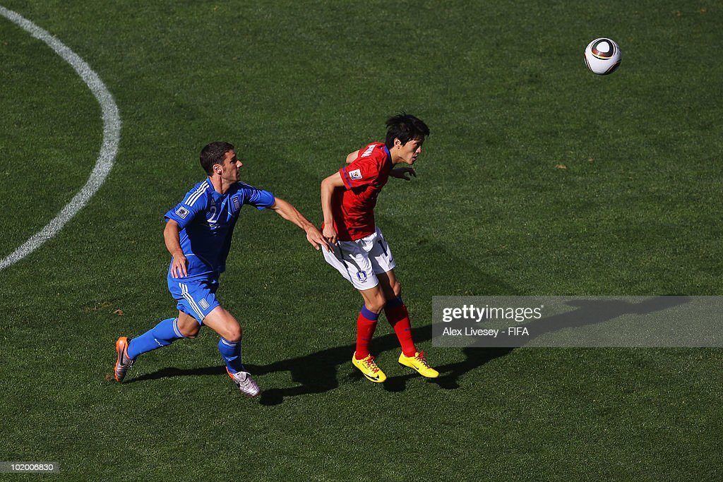 Giourkas Seitaridis of Greece challenges Lee ChungYong of South Korea during the 2010 FIFA World Cup South Africa Group B match between South Korea...