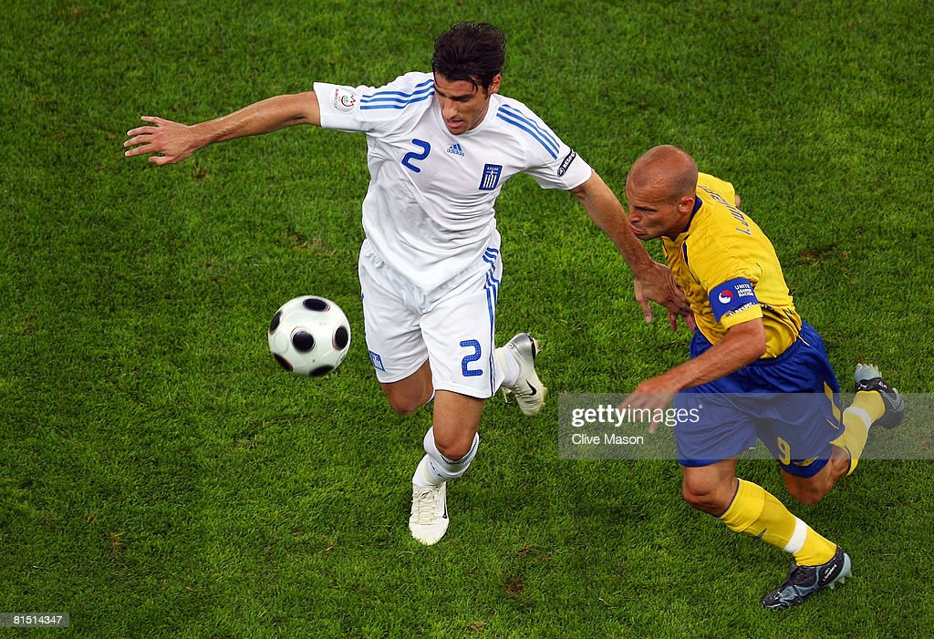 Giourkas Seitaridis of Greece is chased by Fredrik Ljungberg of Sweden during the UEFA EURO 2008 Group D match between Greece and Sweden at Stadion...