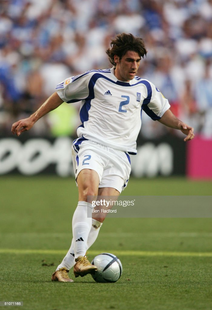 Giourkas Seitaridis of Greece runs with the ball during the UEFA Euro 2004 Final match between Portugal and Greece held on July 4 2004 at the Estadio...
