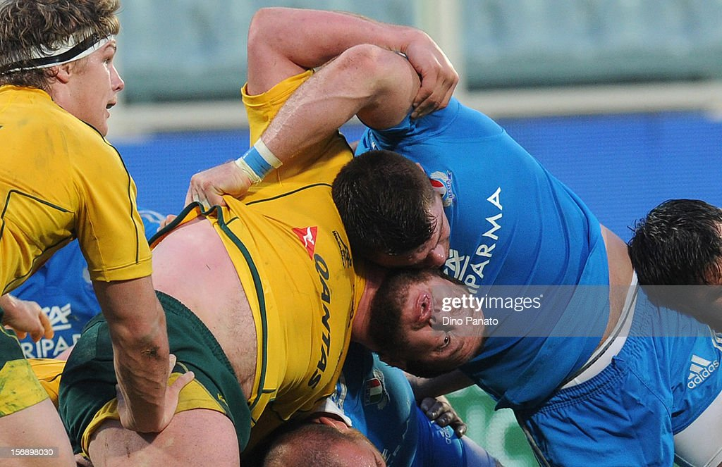 Giovanbattista Venditti (R) of Italy and Ben Tupuai of Australia in action during the international rugby test match between Italy and Australia at Artemio Franchi on November 24, 2012 in Florence, Italy.