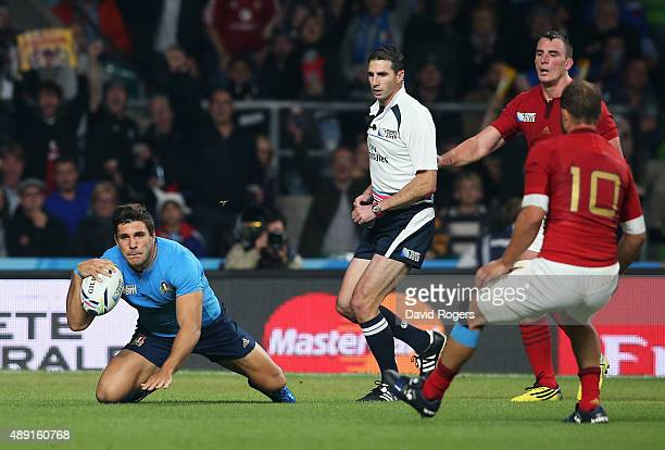 Giovanbattista Venditti of Italy scores his teams furst try during the 2015 Rugby World Cup Pool D match between France and Italy at Twickenham...