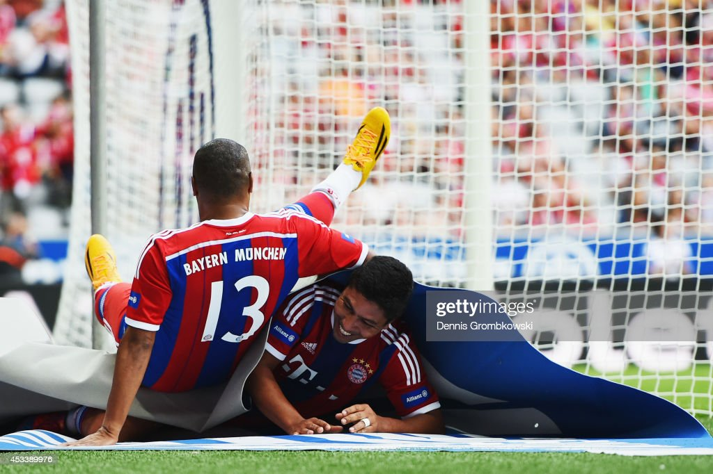 Giovane Elber of FCB AllStars celebrates with team mate Paulo Sergio after scoring his team's second goal during the friendly match between FC Bayern...