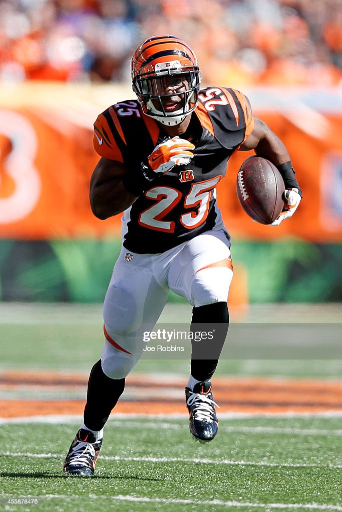 Giovani Bernard of the Cincinnati Bengals carries the ball during the third quarter at Paul Brown Stadium on September 21 2014 in Cincinnati Ohio
