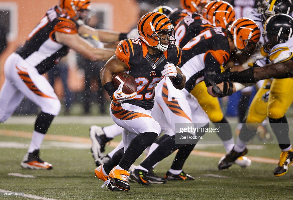 Giovani Bernard of the Cincinnati Bengals carries the ball in the first half against the Pittsburgh Steelers during the AFC Wild Card Playoff game at...